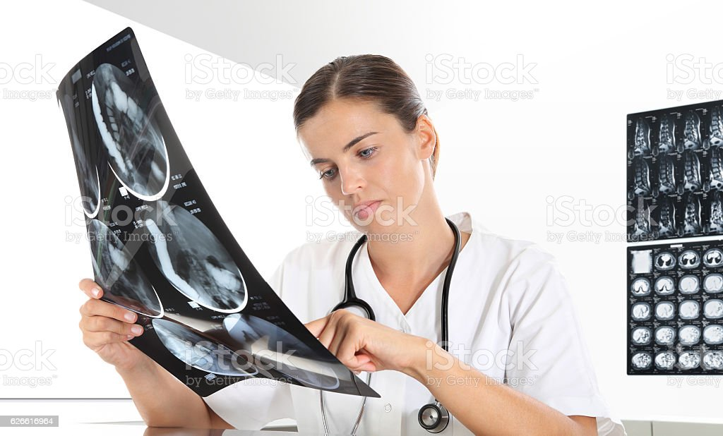 Radiologist woman checking xray, healthcare, medical and radiology stock photo
