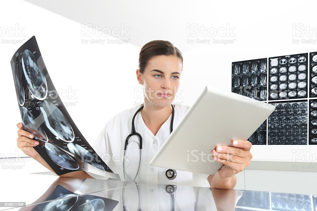 Radiologist woman checking xray, with tablet, healthcare, medical stock photo