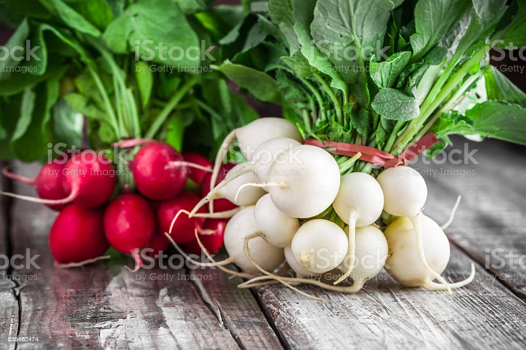 Radish group on old wooden table stock photo