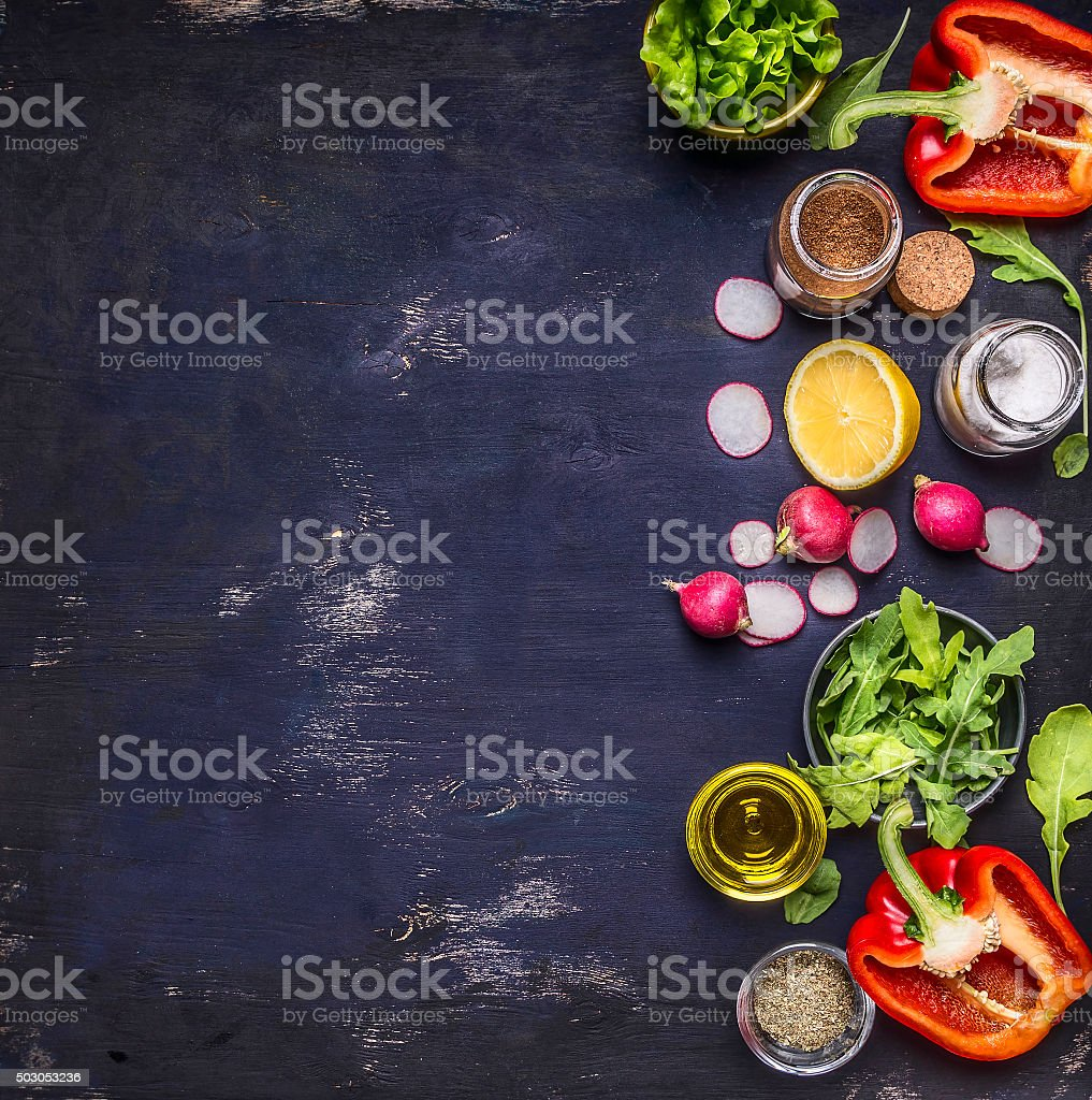 radish lemon arugula lettuce salt seasoning wooden background top view stock photo