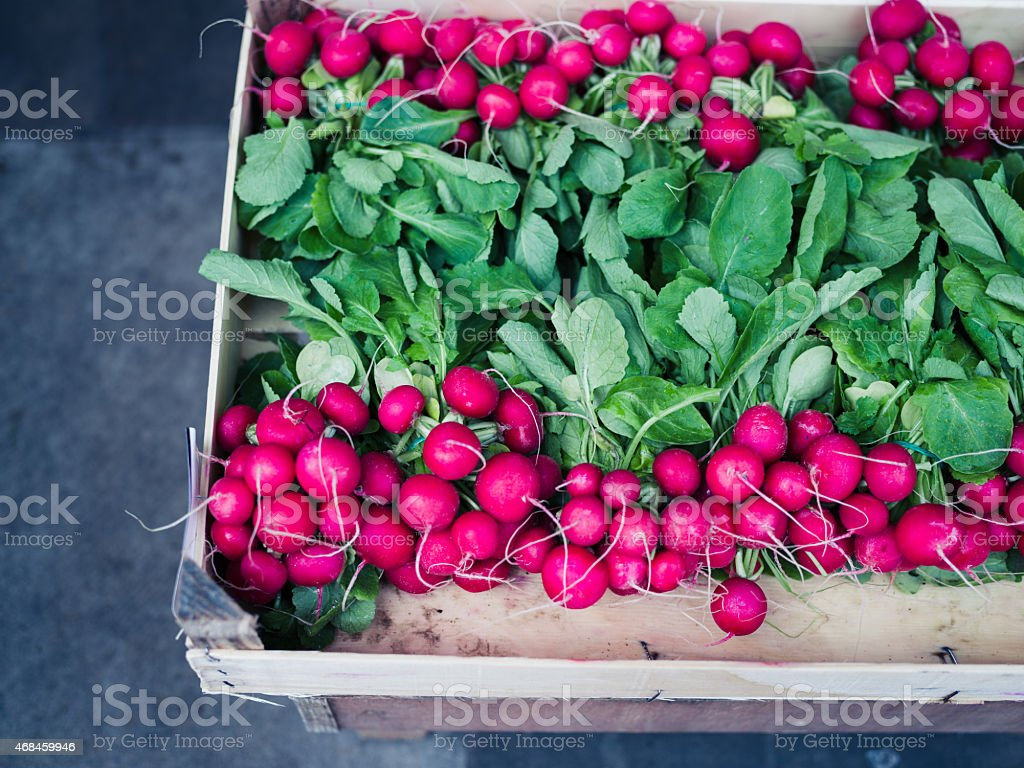 Radishes in box at market stock photo