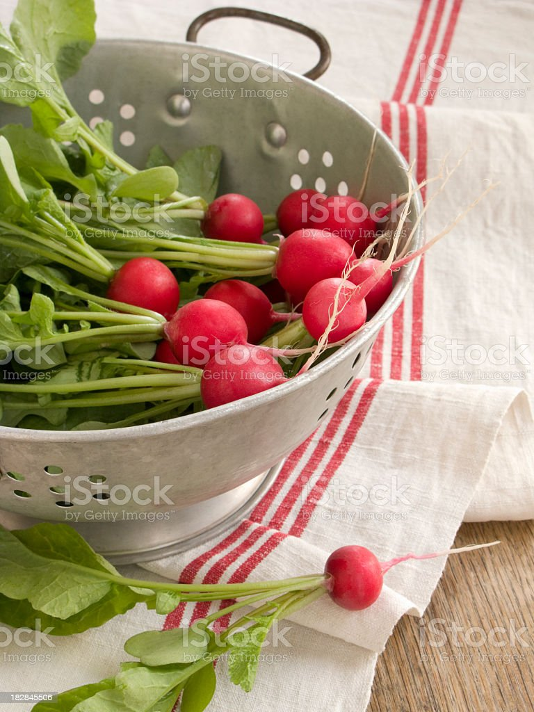 Radishes in colander royalty-free stock photo