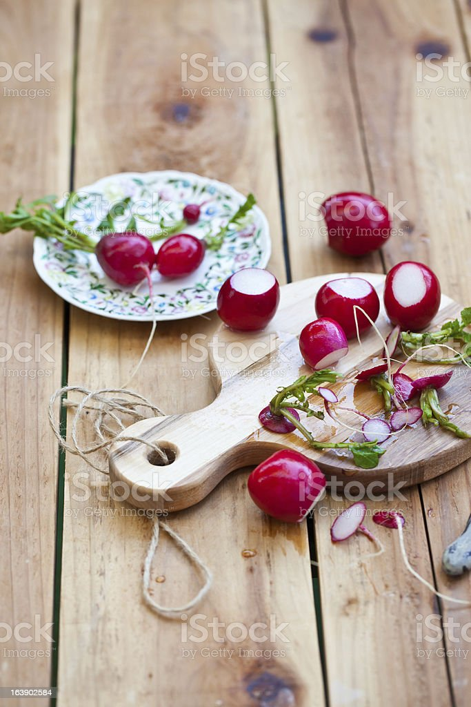 Radishes on cutting board royalty-free stock photo