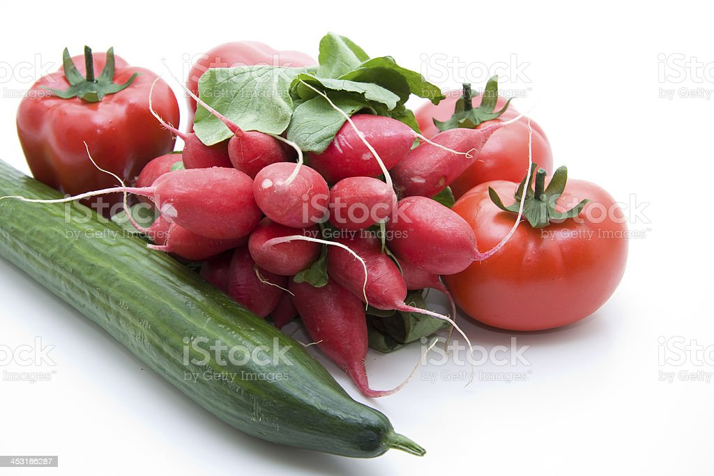 Radishes with cucumber and tomatoes stock photo