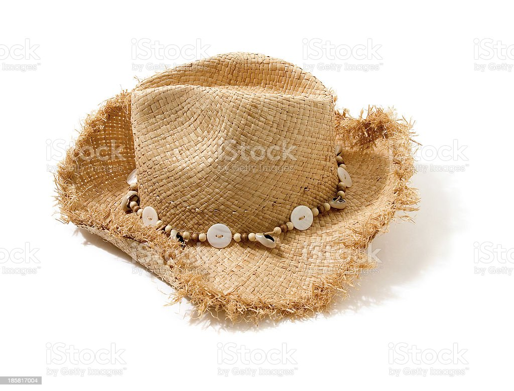 Raffia fringed farmer hat with beads and buttons hatband stock photo