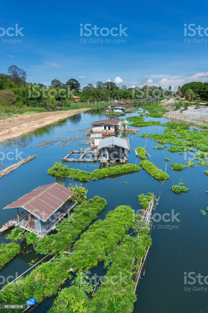 Raft housing and eco farmings floating in a river stock photo