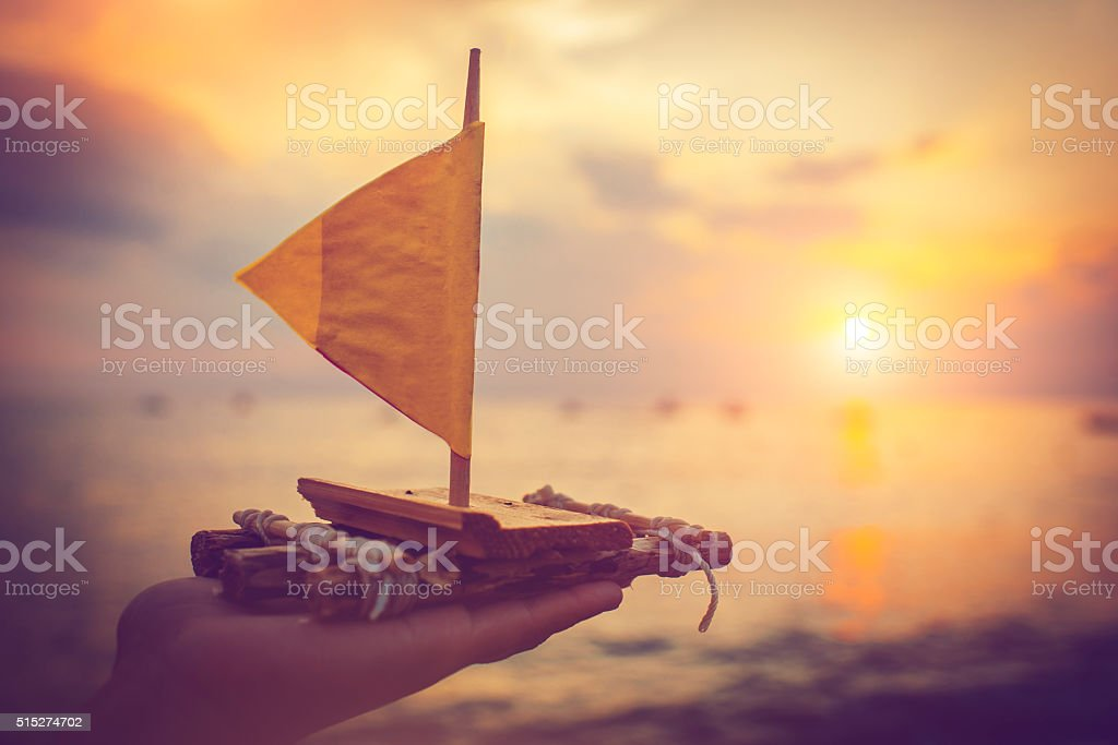 Raft in sunset stock photo