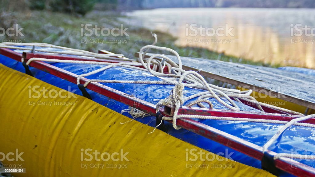 Raft on shore of mountain misty river close-up stock photo
