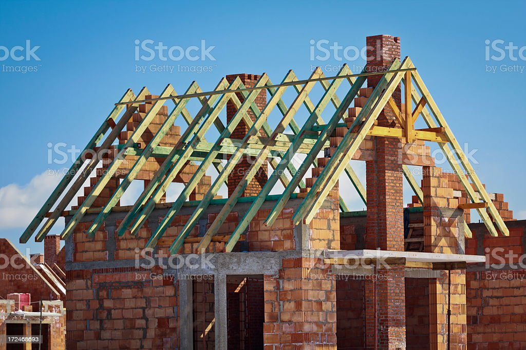 Rafter framing in small residential home under construction royalty-free stock photo