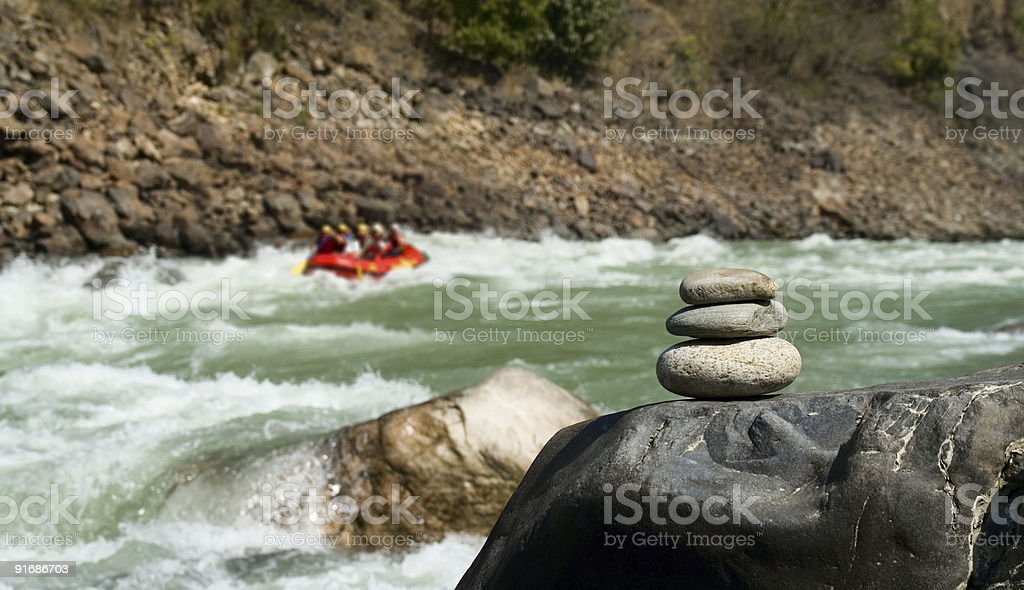 Rafting and pebble stack royalty-free stock photo