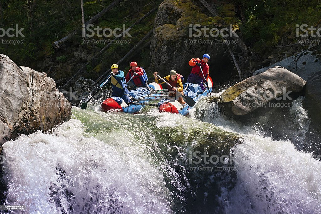 Rafting on dangerous mountain river stock photo