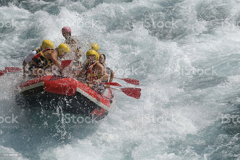 Rafting on white water in a storm stock photo