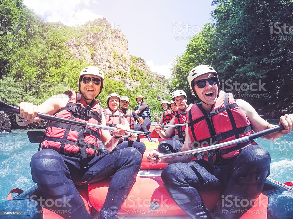 Rafting with friends stock photo