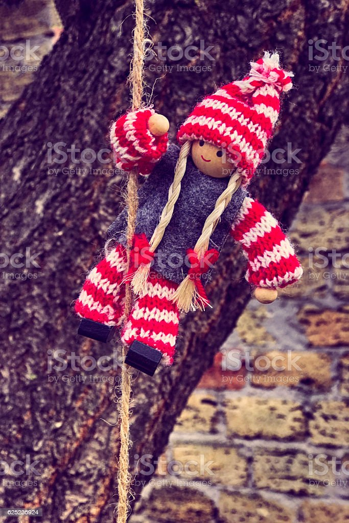 Rag doll hanging on a rope stock photo