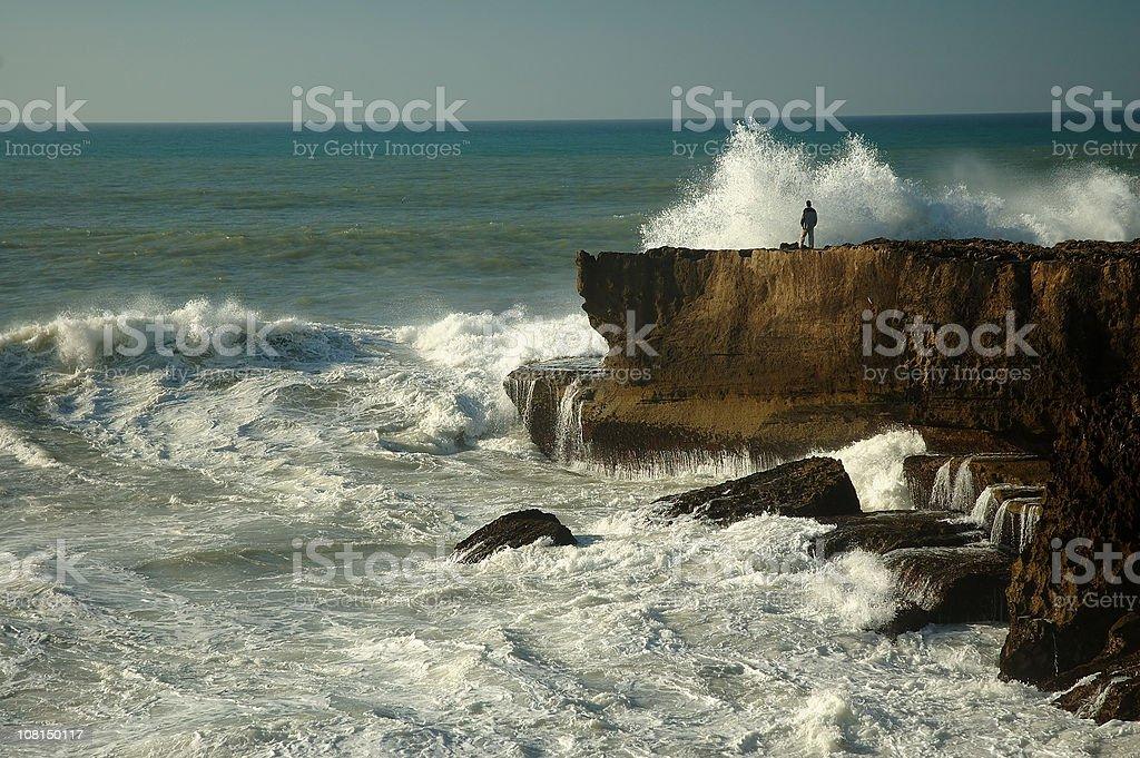 Raged ocean against man royalty-free stock photo