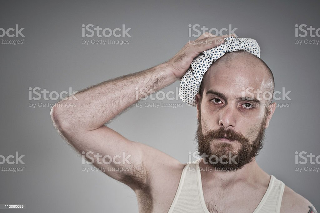 Ragged looking man with the flu royalty-free stock photo