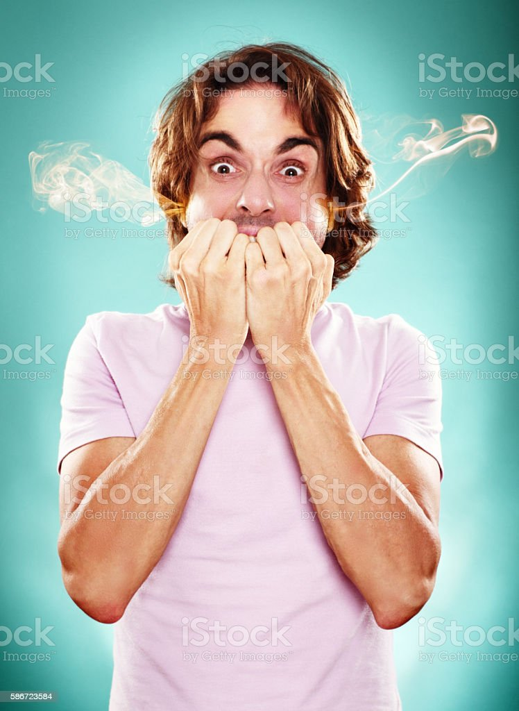 Raging man with smoke or steam ejected from his ears stock photo
