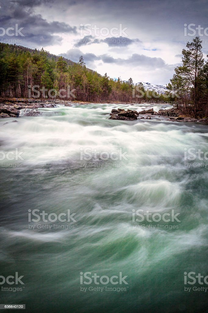 Raging river in the Sognefjell Mountains stock photo