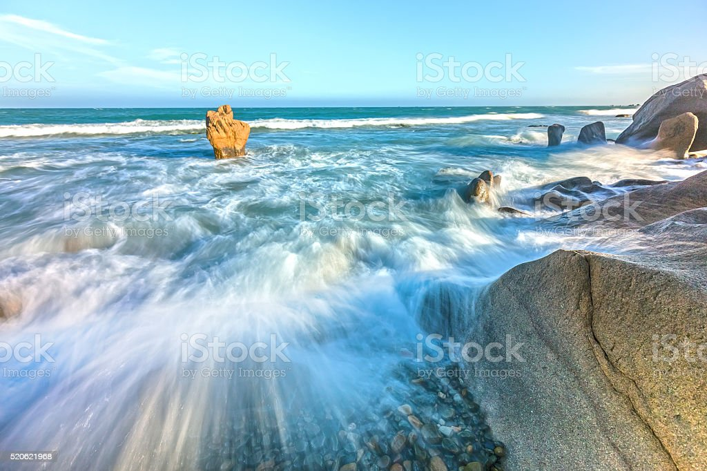 Raging waves hitting the reef stock photo