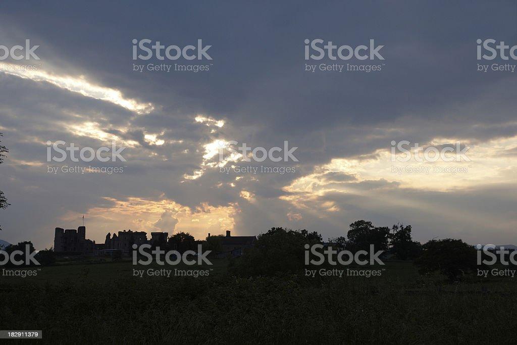 Raglan Castle silhouette at dusk stock photo
