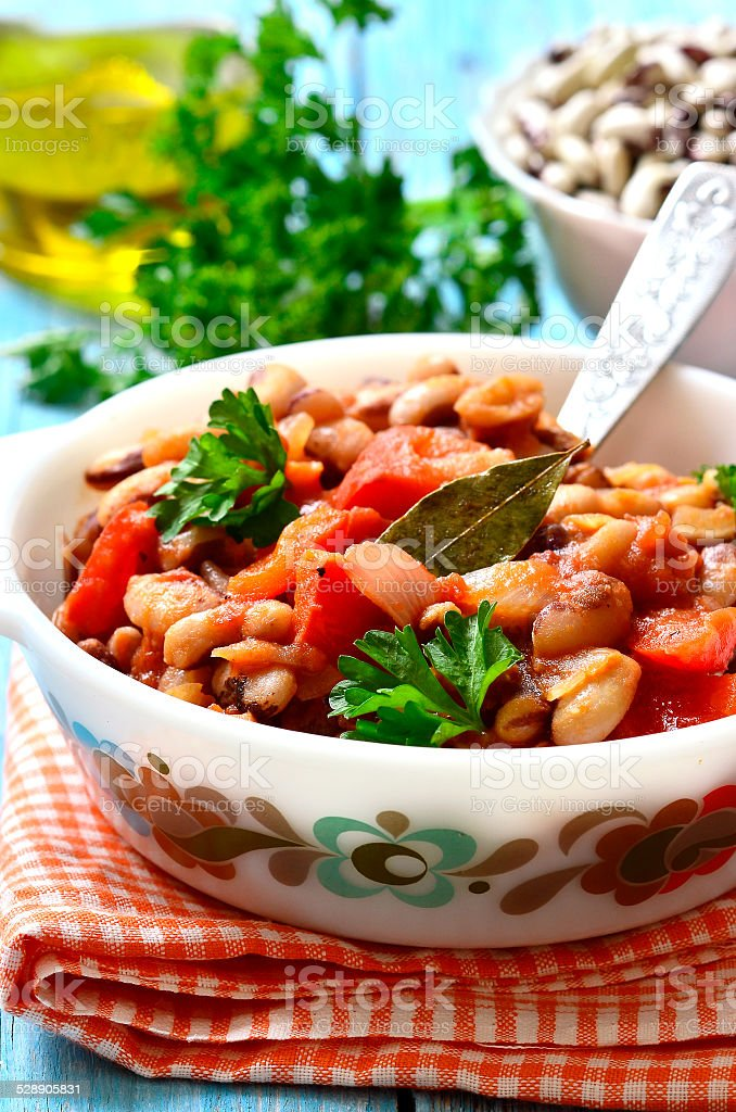 Ragout from beans with bell pepper and onion. stock photo