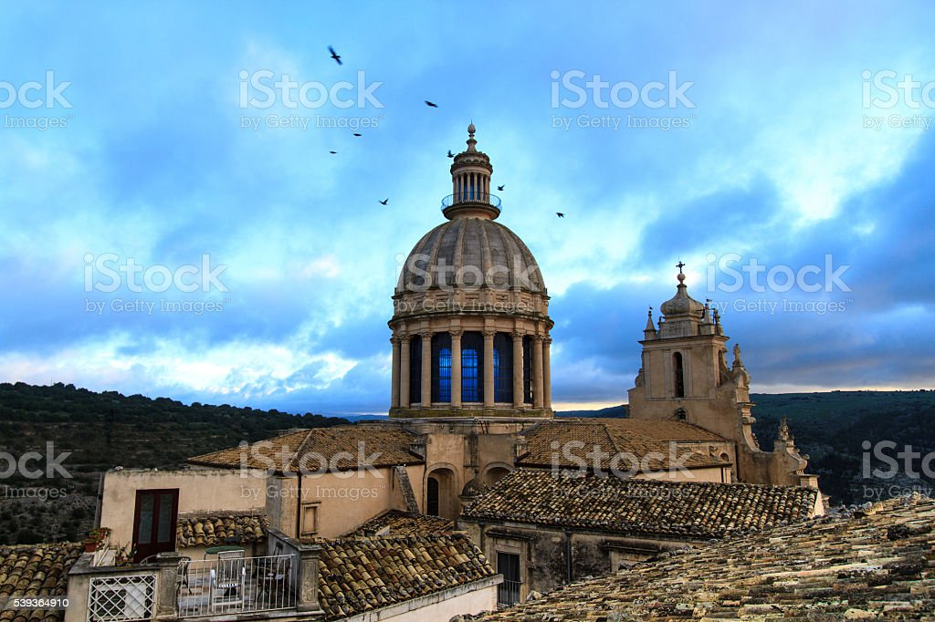 Ragusa Ibla, Sicily: Cathedral of St George at Dusk, Birds stock photo