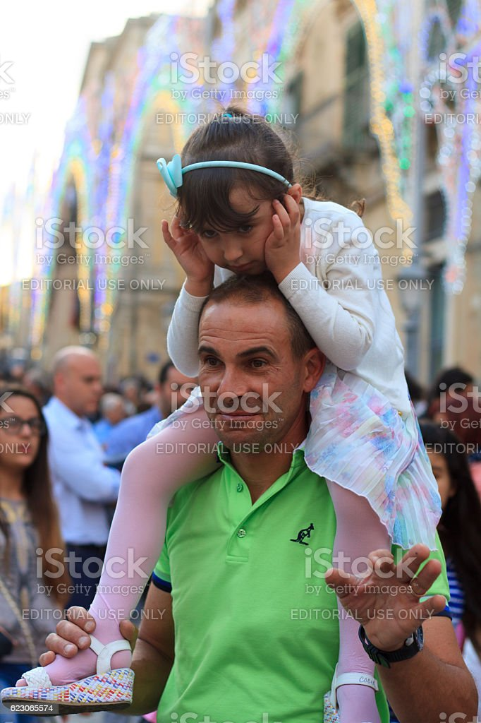 Ragusa Ibla, Sicily: Father and Daughter at Saint Day Celebration stock photo