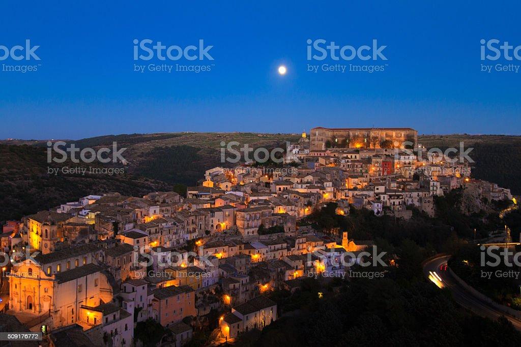 Ragusa Ibla, Sicily: Panorama at Dusk, Full Moon, Purple Sky stock photo