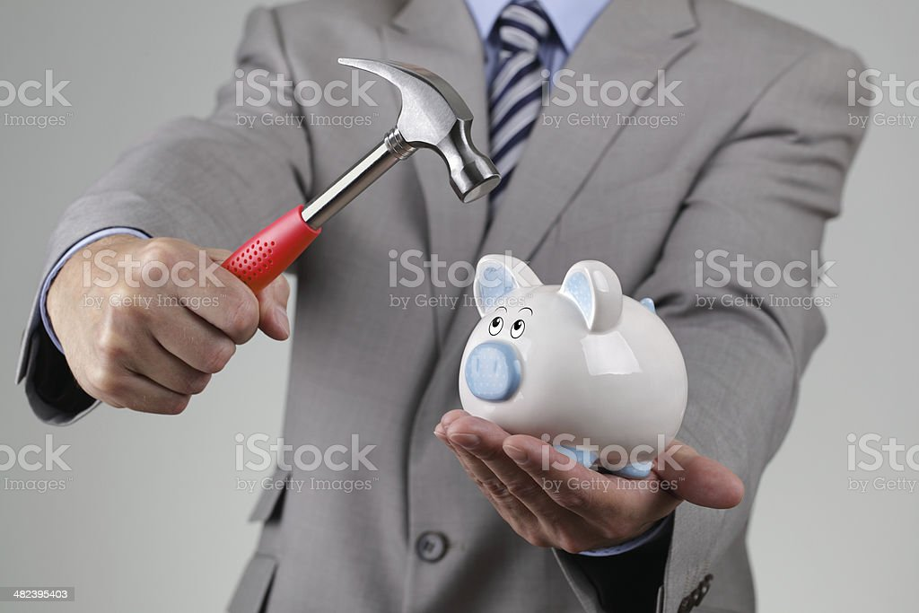 Raiding the piggy bank stock photo
