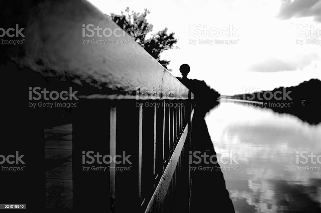 Rail along the river in Black and White stock photo