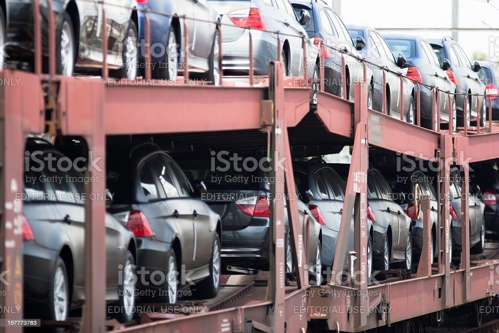 rail freight transport autorack transporter loaded with new BMW cars stock photo