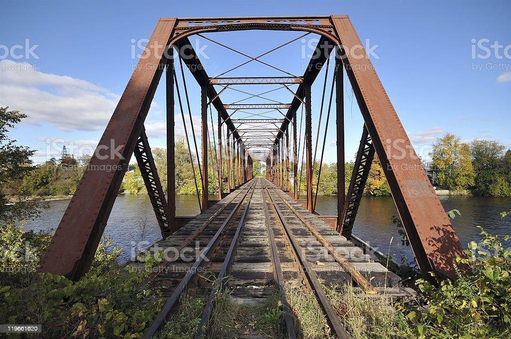 Rail length across the river  on steel bridge royalty-free stock photo