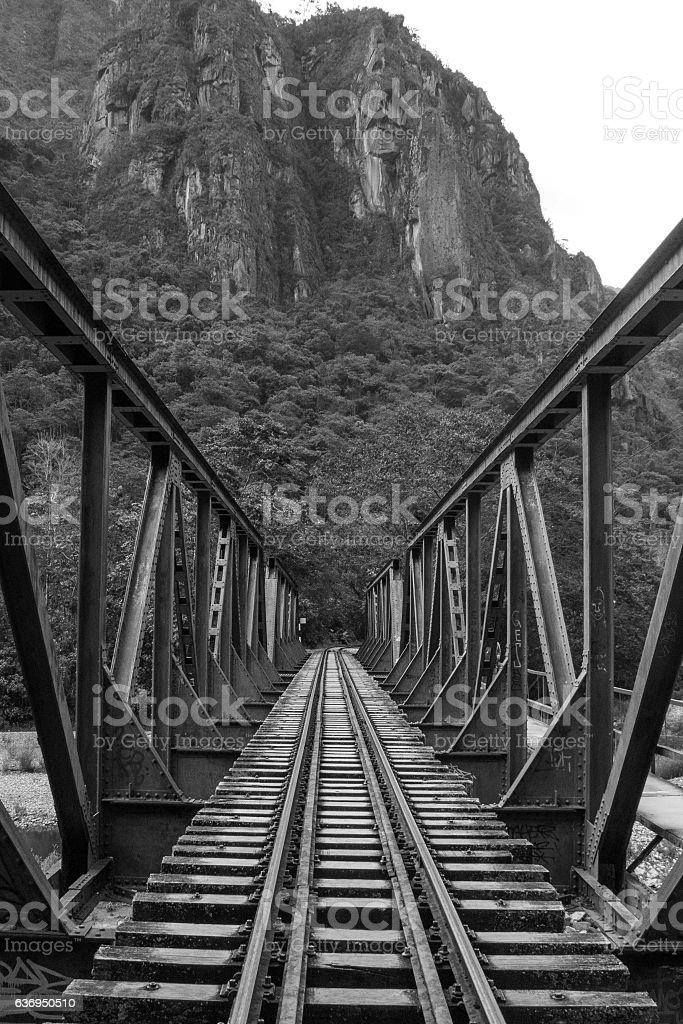 Rail road iron bridge crossing Vilcanota river stock photo