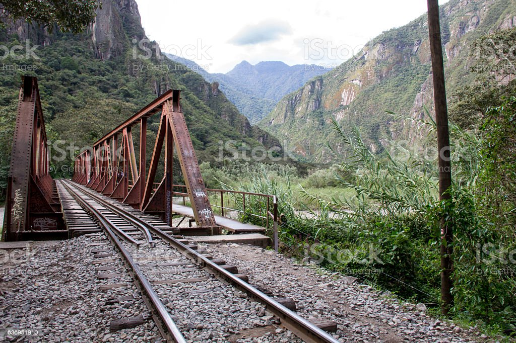 Rail road red iron bridge crossing Vilcanota river stock photo