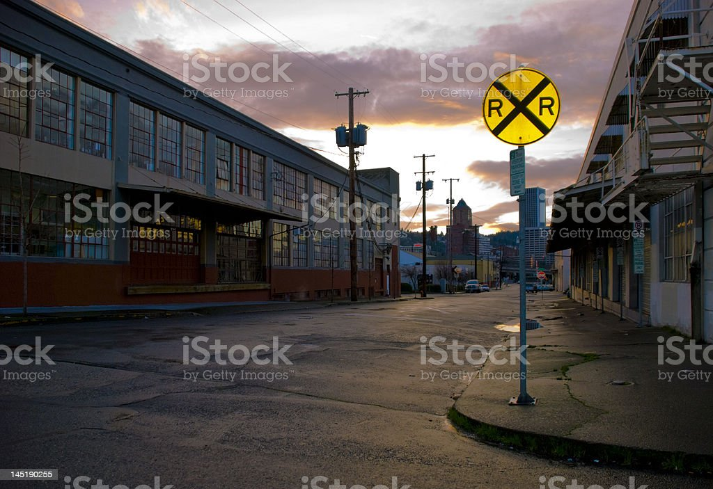 rail road sign and warehouses royalty-free stock photo