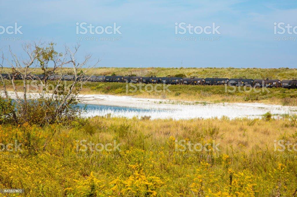 Rail tank cars near potash pond 1 stock photo