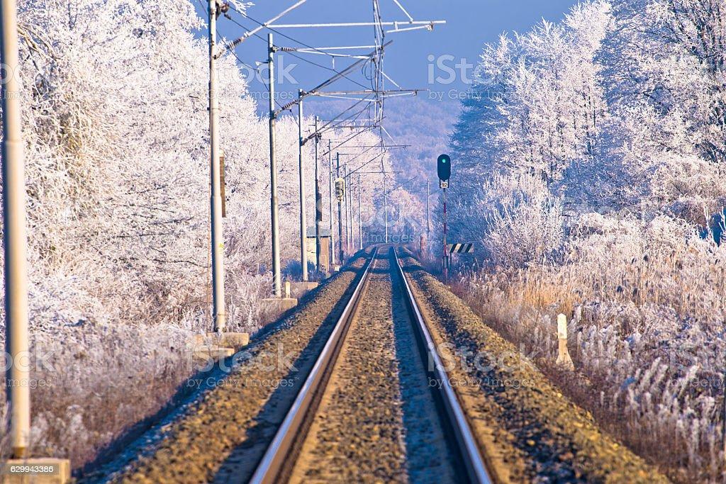 Rail track in winter landscape stock photo
