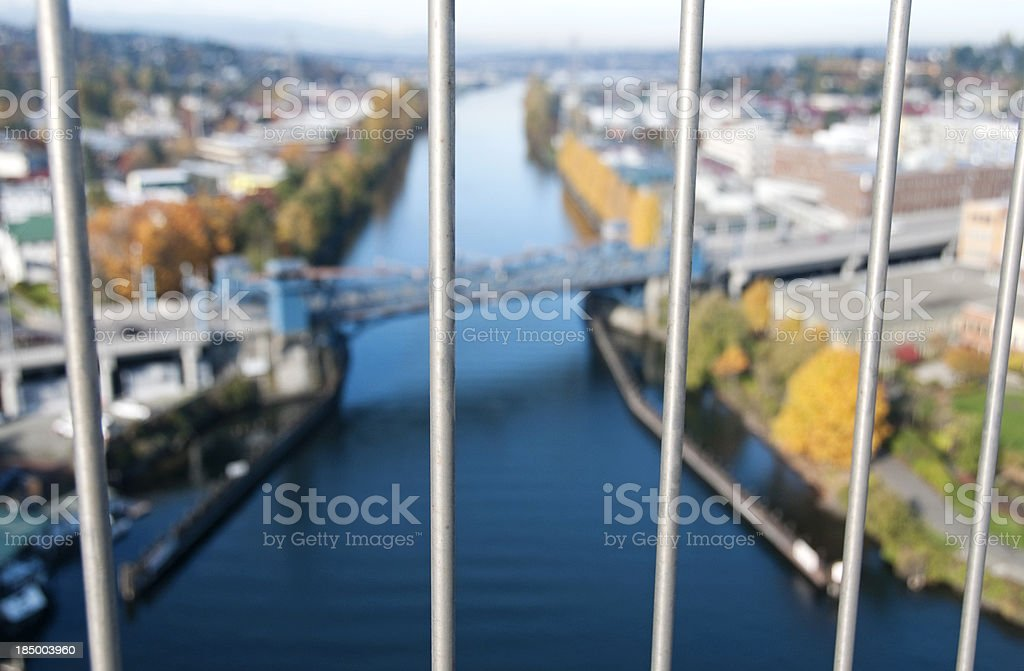 Railings of suicide deterrent fence on high bridge stock photo