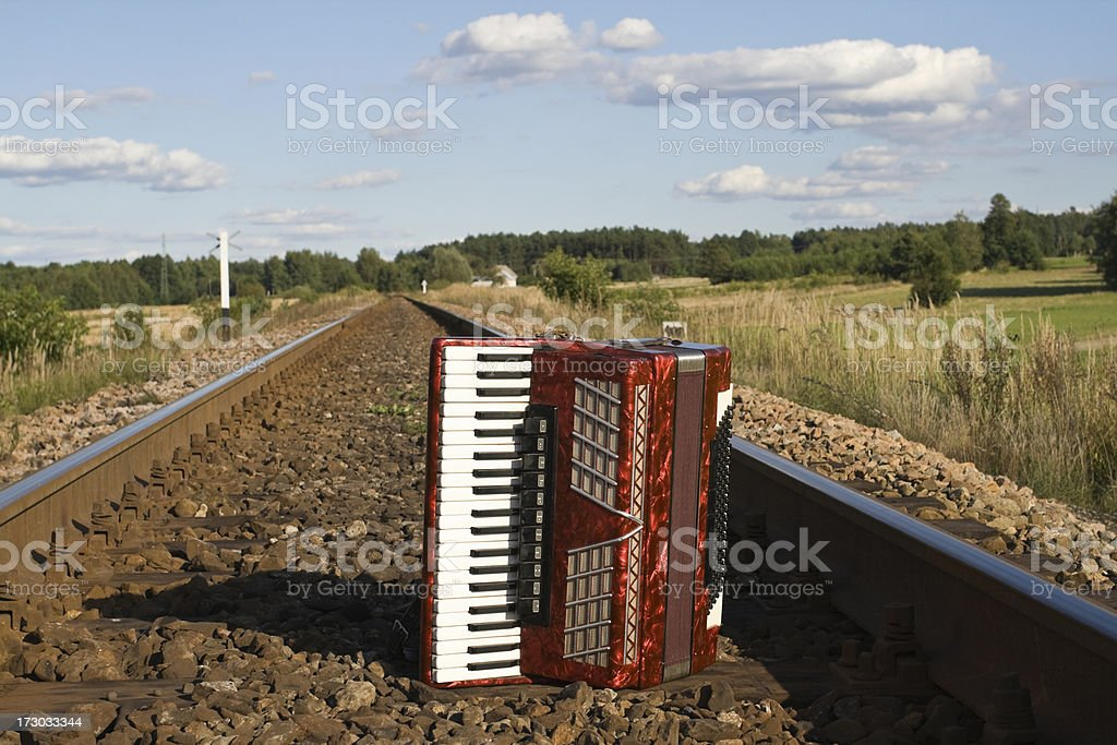 Railroad and accordion royalty-free stock photo