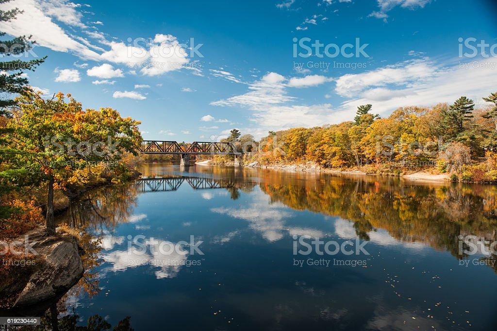 Railroad bridge over the Androscoggin River in Brunswick, Maine stock photo