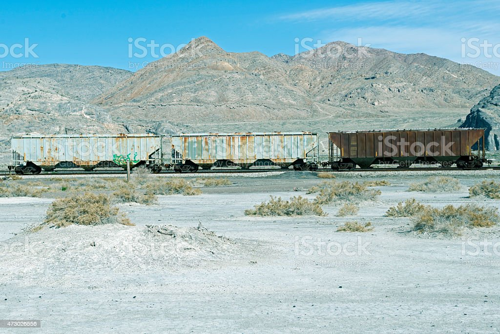 Railroad cars on siding at salt manufacturing plant in Utah stock photo