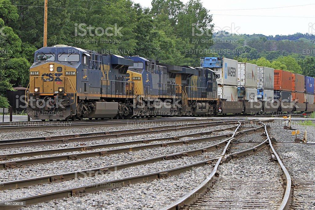 CSX railroad container freight train, 3 GE locomotives stock photo