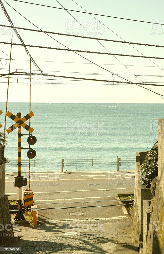 Railroad crossing and the sea stock photo
