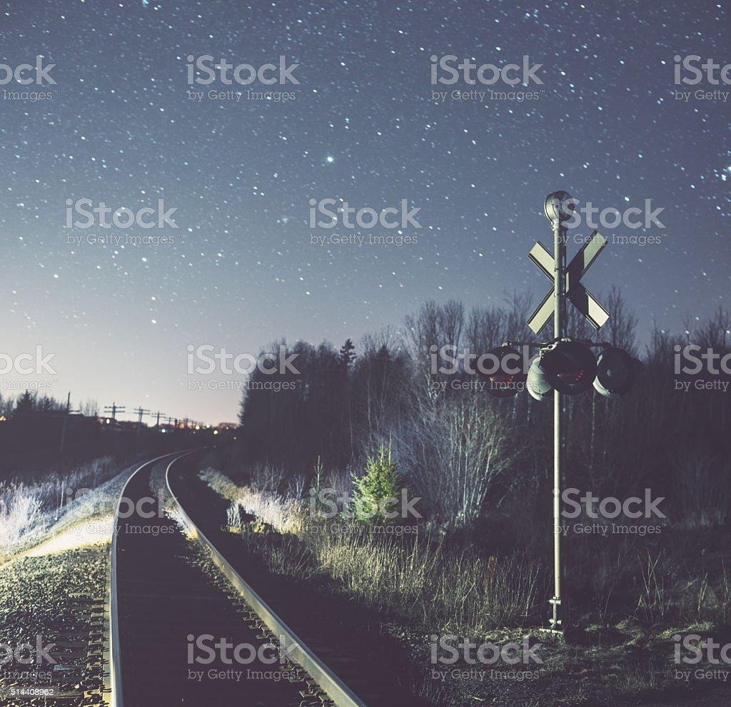 Railroad Crossing in the Stars stock photo