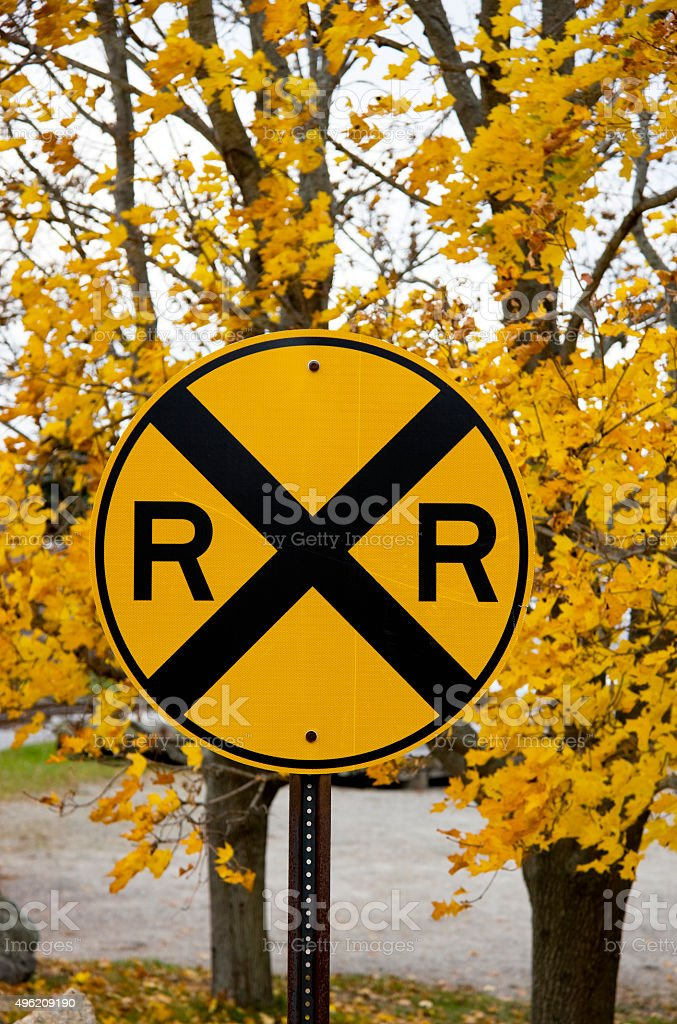 Railroad crossing sign in disguise. stock photo