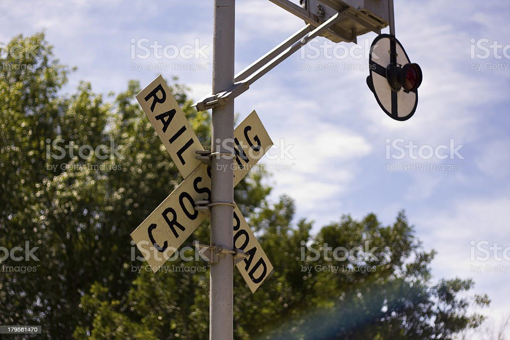 Railroad Crossing sign with blue skies stock photo