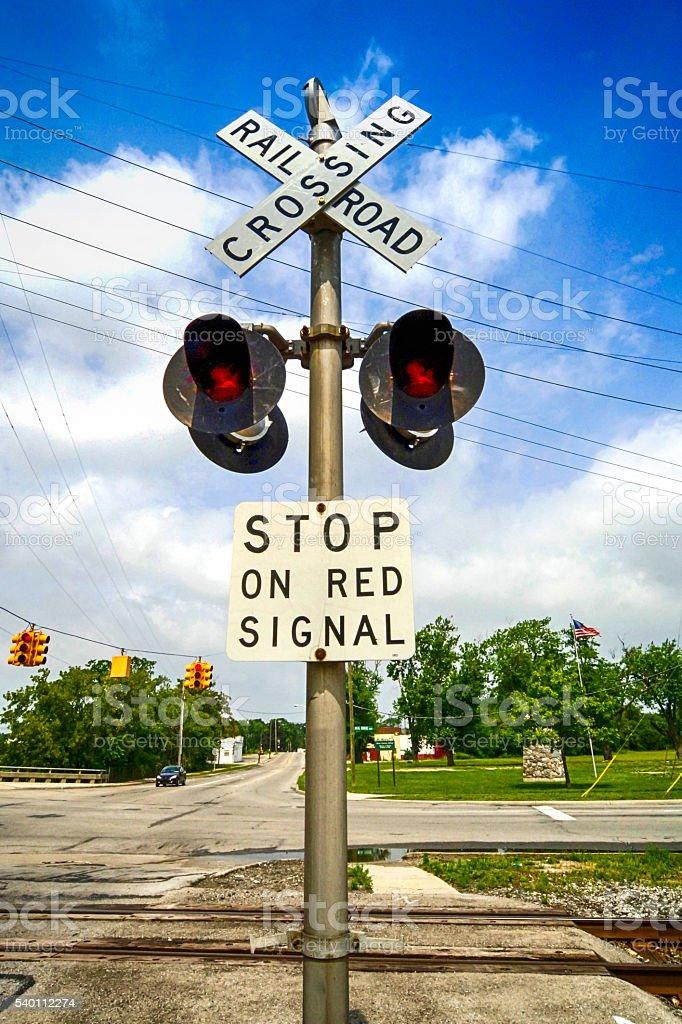 Railroad Crossing signpost and lights near Monroe MI stock photo