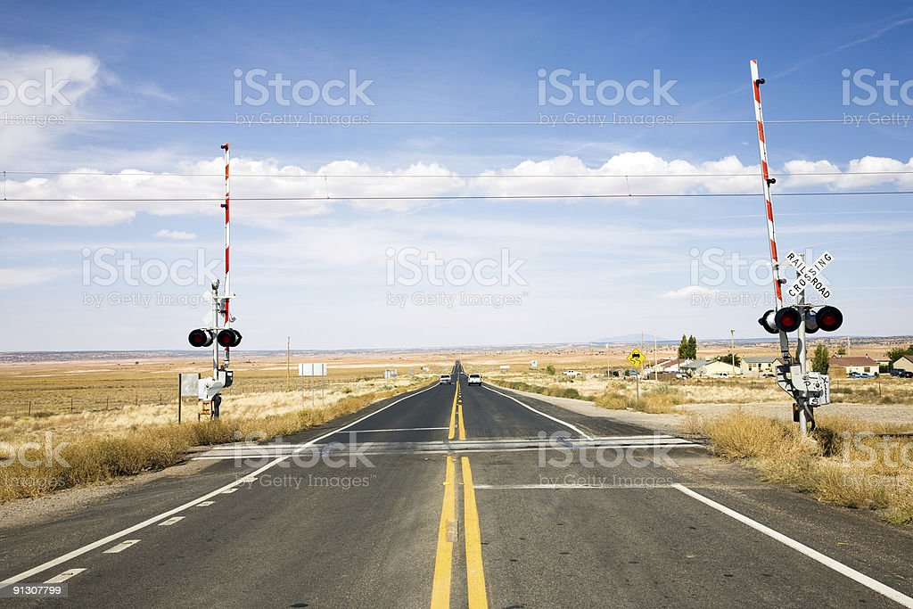 Railroad crossing with gates stock photo