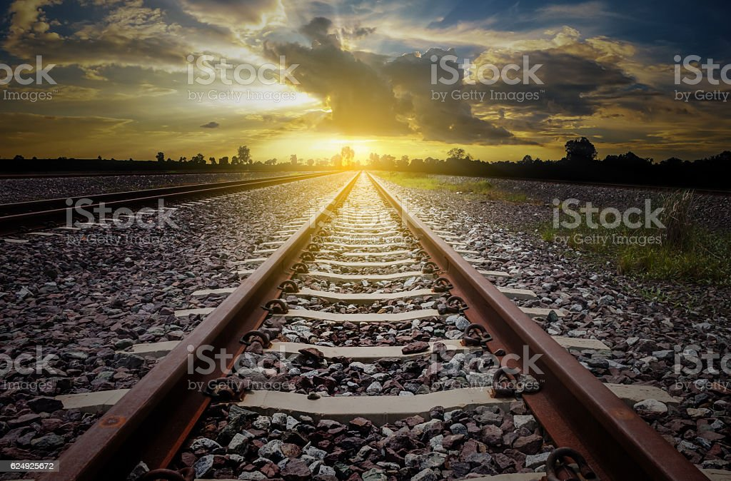railroad for transportation with sunlight and silhouette, dark t stock photo