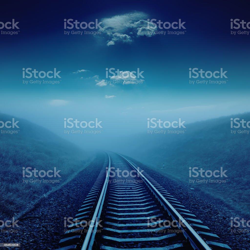 railroad in night under blue moonlight stock photo